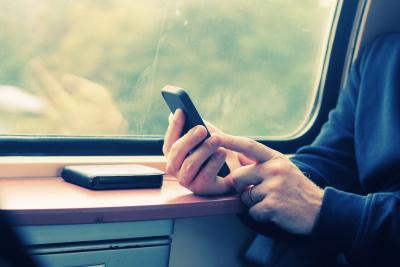 close up man's hands using cellphone